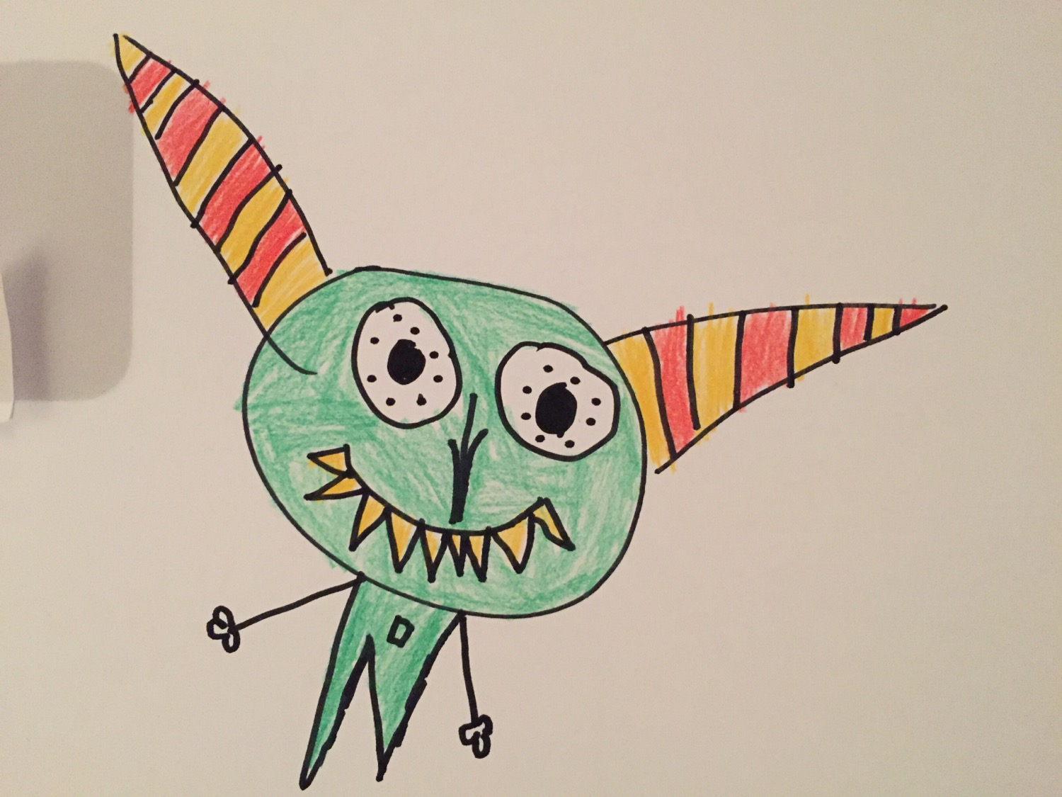 A monster drawn by my daughter today. The first time she used an alternating color pattern.