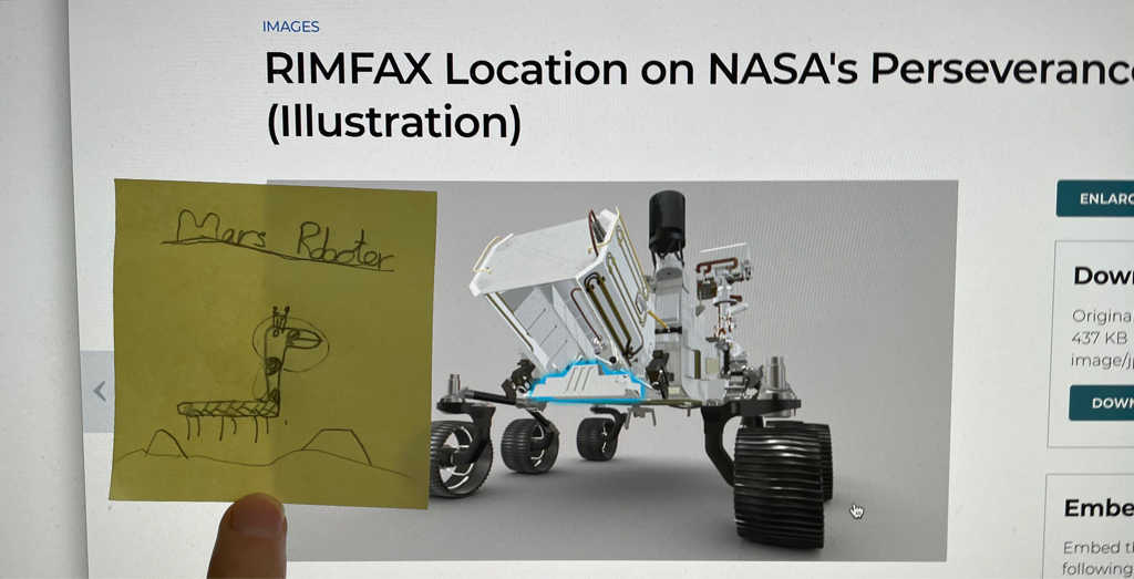 In eager anticipation of today's landing of Preseveran e. The postit contains an image of how the rover looks in my daughter's imagination.