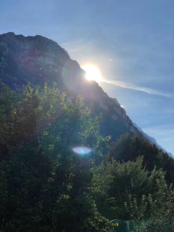 Sun behind the mountain.